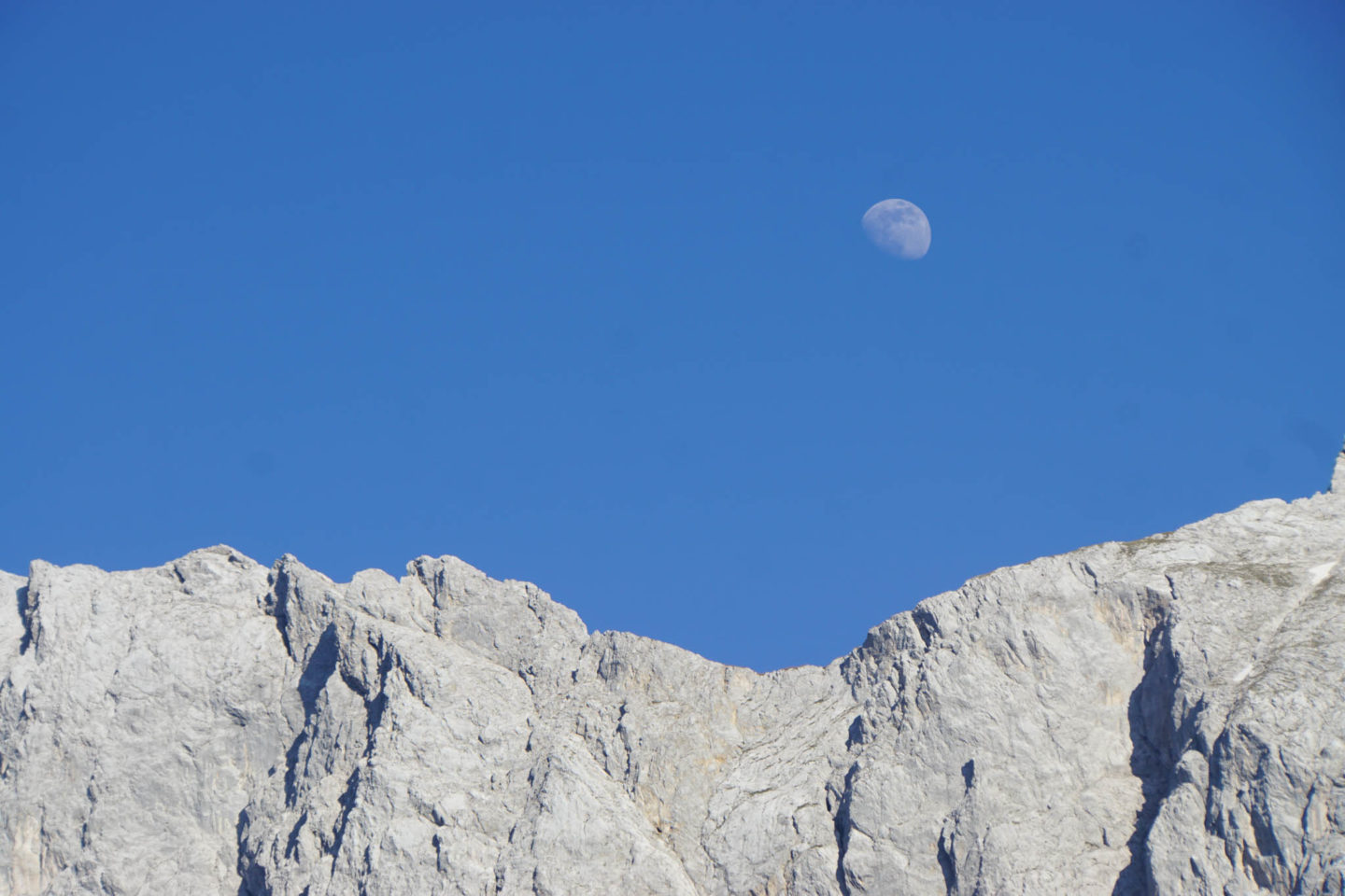 Rising moon over mountains at Eibsee